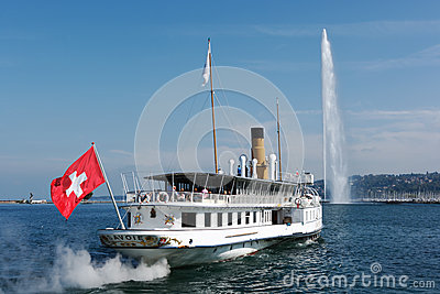 Steam boat leaving Geneva harbor Editorial Stock Image