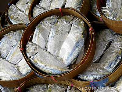 Steamed mackerel fish on the bamboo round basket