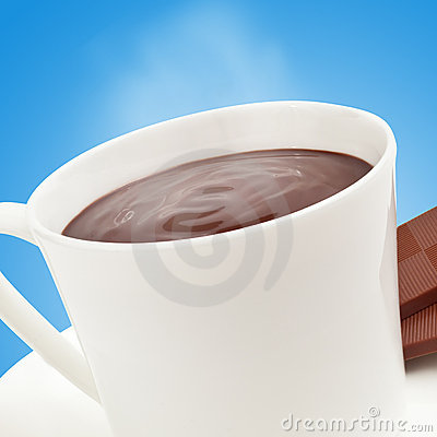Steaming hot chocolate on blue