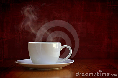 Steaming white cup of coffee or tea