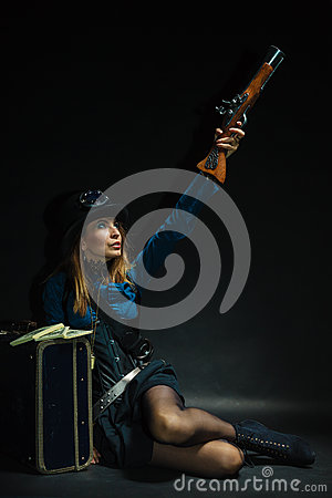 Steampunk girl armed and dangerous. Stock Photo