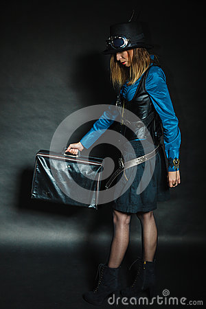 Steampunk girl with retro bag. Stock Photo