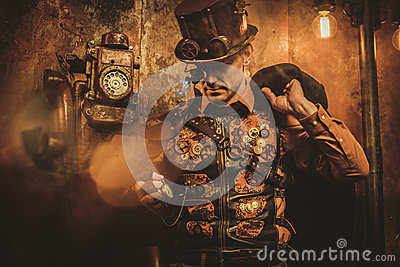 Steampunk style man with various mechanical devices on vintage steampunk background Stock Photo