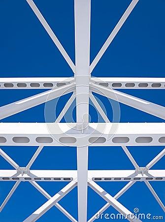 Steel beams against the blue sky