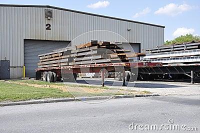 Steel beams on trucks