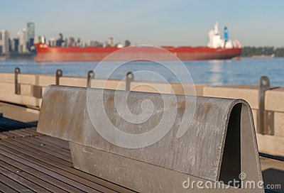 Steel Bench on Pier with Ship
