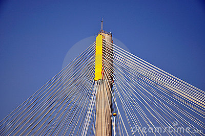 Steel cable on pole of bridge