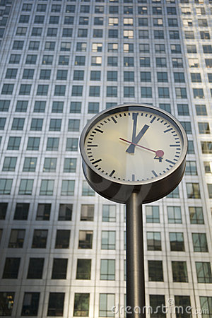 Free Steel Clock And Canary Wharf Tower Royalty Free Stock Photo - 8681055