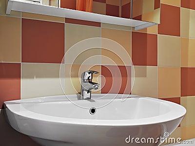 Steel faucet in a modern bathroom