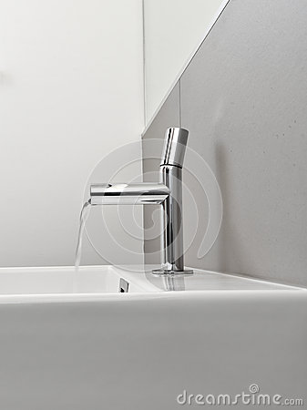 Steel faucet in a modern bathroom