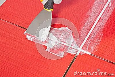 Steel pallet fill up joints between tiles