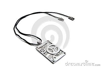 Steel pendant on a black lace