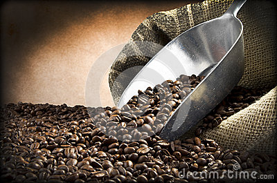 Steel scoop and Coffee beans
