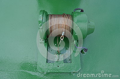 Steel wire on a green cable drum aboard a ship
