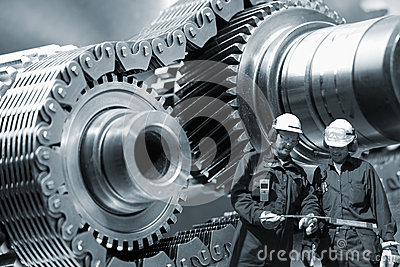Steel-workers and machinery