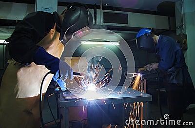 Steel workers welding