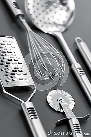 Steinless kitchen stuff on gray background