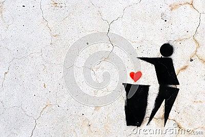 Stencil Graffiti of a heart thrown in a trash bin