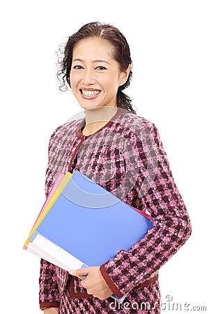Stående av den asiatiska affärskvinnan