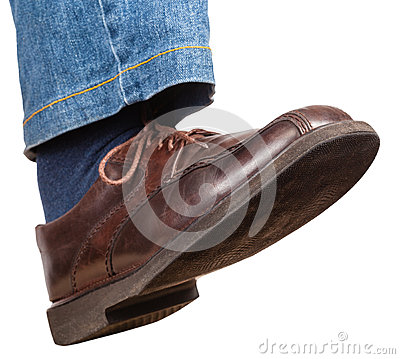Free Step Of Male Right Leg In Jeans And Brown Shoe Stock Photos - 65140753