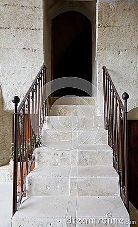 Steps railings archway dark doorway