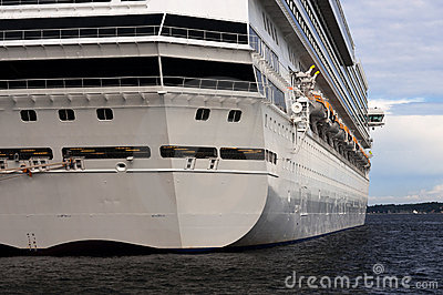 A stern view of a large cruise ship in port