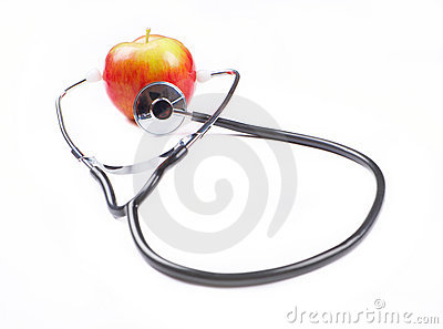 Stethoscope and apple over white background