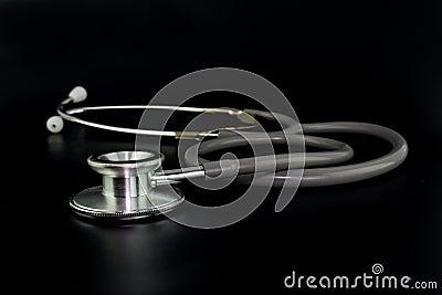 Stethoscope on black background