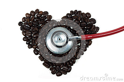Stethoscope on a coffee beans in shape of heart