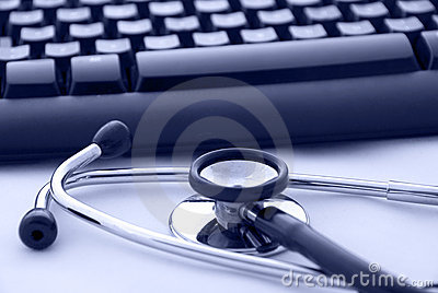 Stethoscope by a computer keyboard