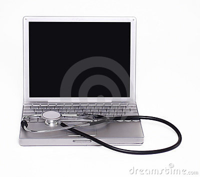 Stethoscope laying on computer