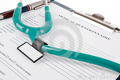 Stethoscope on medical document