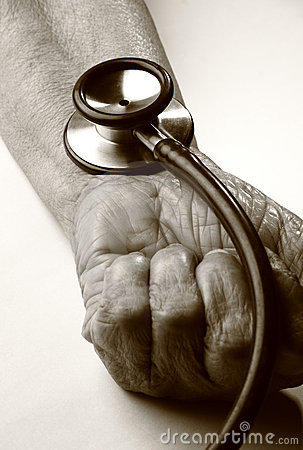 Stethoscope on old hand