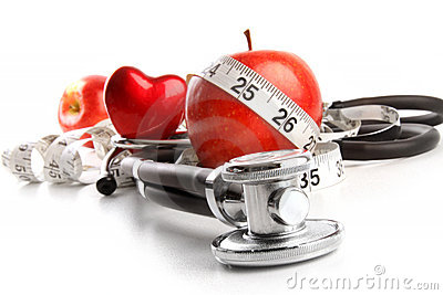 Stethoscope with red apples on a white