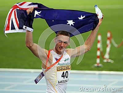 Steven Solomon viert bronsmedaille Redactionele Stock Foto