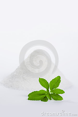 Stevia with a pile of sugar vertical