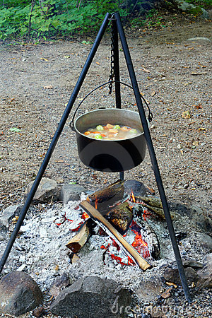 Stew cooks over a open fire