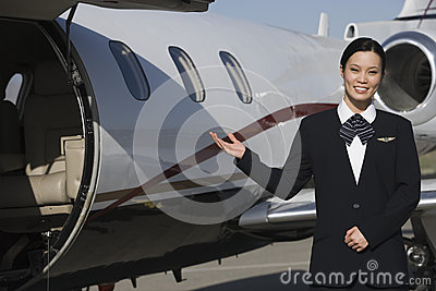 Stewardess Gesturing At Airfield