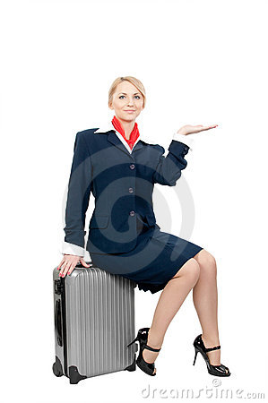 A stewardess holding something