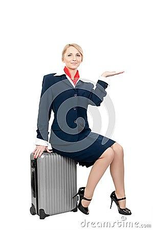 A stewardess holding something