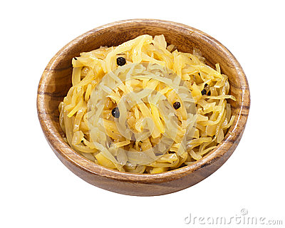 Stewed cabbage in a wooden bowl