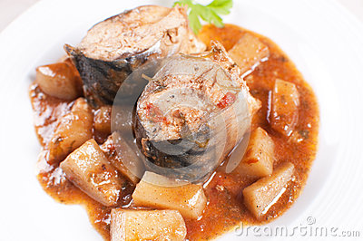 Stewed mackerel fish pieces with potatoes