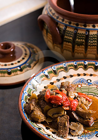 Stewed meat with mushrooms and sweet pepper
