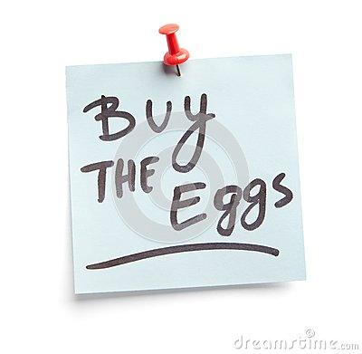 Sticky note with text Buy the eggs on it