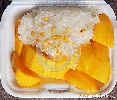 Sticky rice and mango on styrofoam