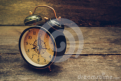 still life with alarm clock on wood table stock photo image 69440842. Black Bedroom Furniture Sets. Home Design Ideas