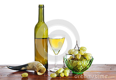 Still life with bottle of wine and grape isolated over white