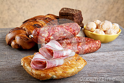 Still-life with bread slices of bacon