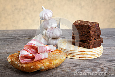 Still-life with bread slices of bacon and garlic