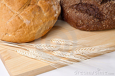 Still life with bread and wheat ears